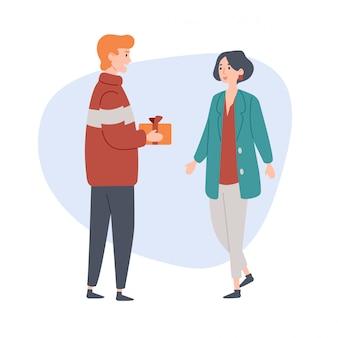 Молодой человек дарит подарок своей девушке.