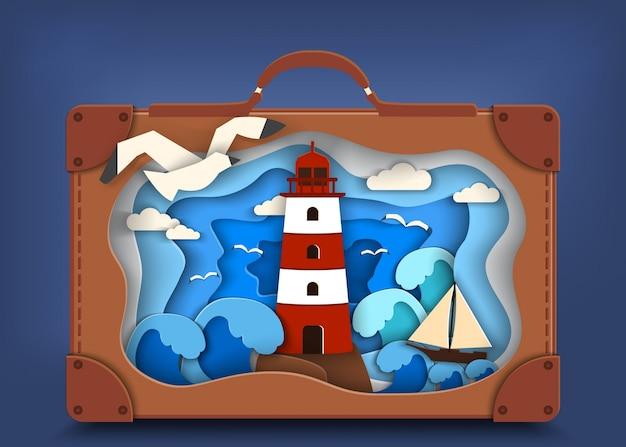 海岸の灯台、茶色のスーツケースの中に