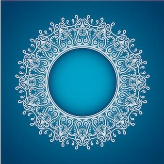 青い背景に白い曼荼羅