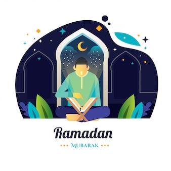 ラマダンの夜の男は聖クルアーンを読みます