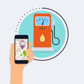 アプリケーション検索ガソリンスタンドでモバイルのスマートフォンを持っている手。