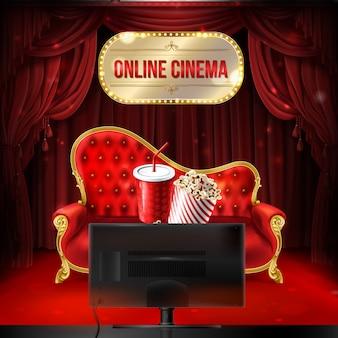 オンラインシネマコンセプト。ポップコーンのバケツとドリンク用のプラスチックカップ付きの赤いベルベットソファ