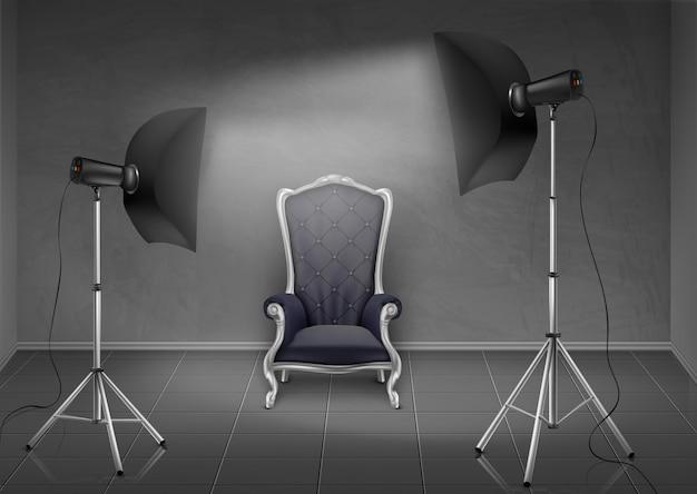 現実的な背景、灰色の壁と床のある部屋、空のアームチェア付きの写真スタジオ