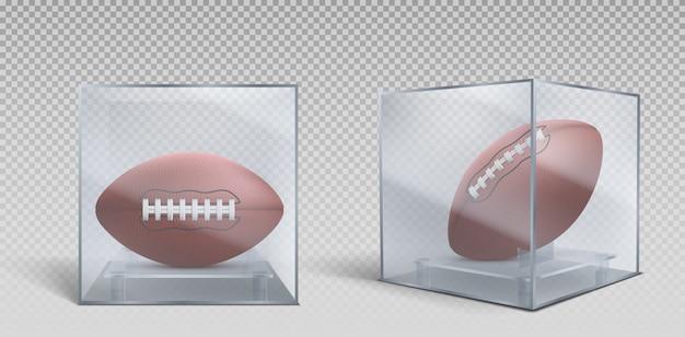 透明なガラスまたはプラスチックの箱に入ったラグビーボール