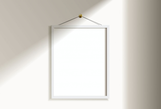 窓の光と影で白い壁に掛かっている最小限の空の垂直の白いフレーム画像。イラストを分離します。