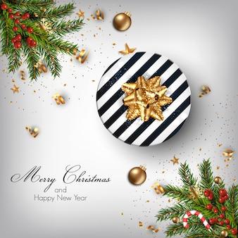 モミの小枝と装飾品でクリスマスの背景