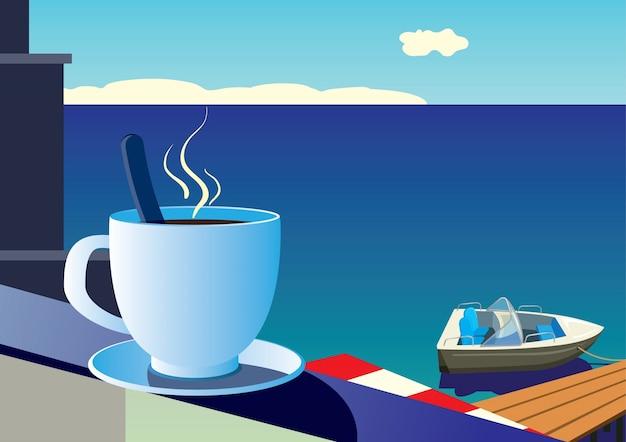 海と帆船の背景に朝のコーヒーのカップ