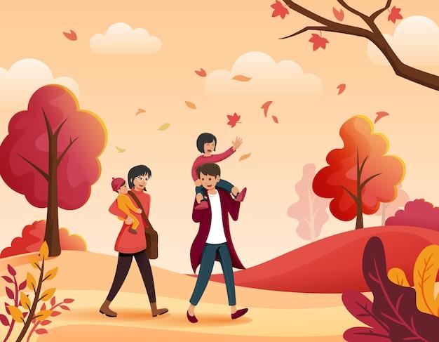 秋に一緒に歩く家族