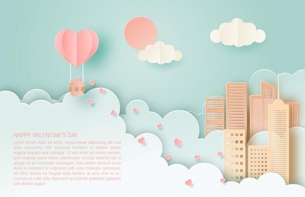 愛のイラスト。バレンタインデーのコンセプト。ハネムーン旅行。ペーパーアートは、都市に浮かぶ熱気球で心をいっぱいにした。