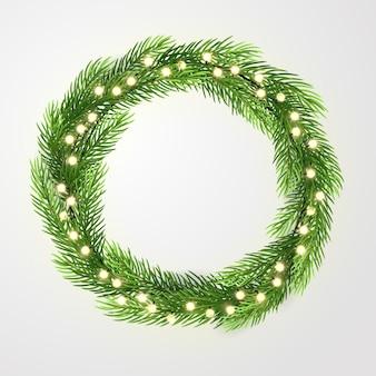 ライトとクリスマスツリーの枝と緑の花輪。