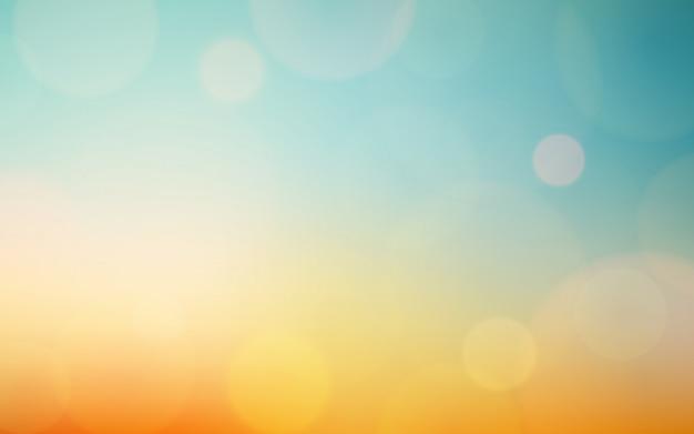 Абстрактный размытия боке и блики на винтажном голубое небо и оранжевый