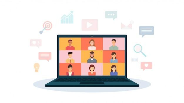 在宅勤務のラップトップでビデオ通話するオフィスの人々のグループ
