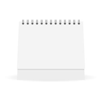 テーブルの上に立つホワイトペーパーカレンダーのモックアップ