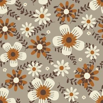 アパレルとファッションの生地に花のアートワーク、枝と葉を持つ秋の花の花輪アイビースタイル。シームレスパターンの背景。