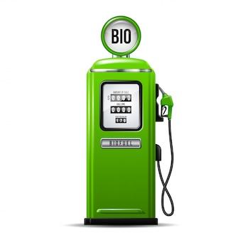 ガソリンポンプの燃料ノズルが付いている緑の明るいガソリンスタンドポンプ。バイオ燃料のコンセプト