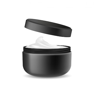 Раскрытая черная косметическая упаковка для сливк изолированной на белизне.