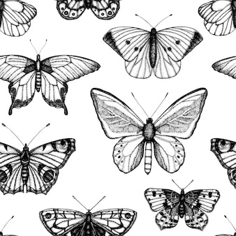 Бесшовный фон из рисованной черно-белых бабочек