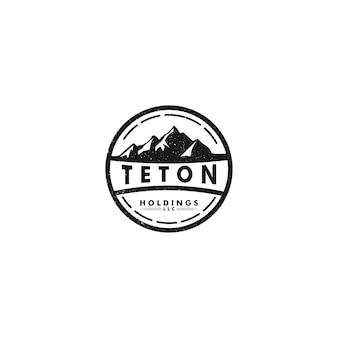 Тетон холдингс логотип