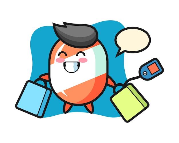 Мультфильм талисман конфеты держит сумку для покупок