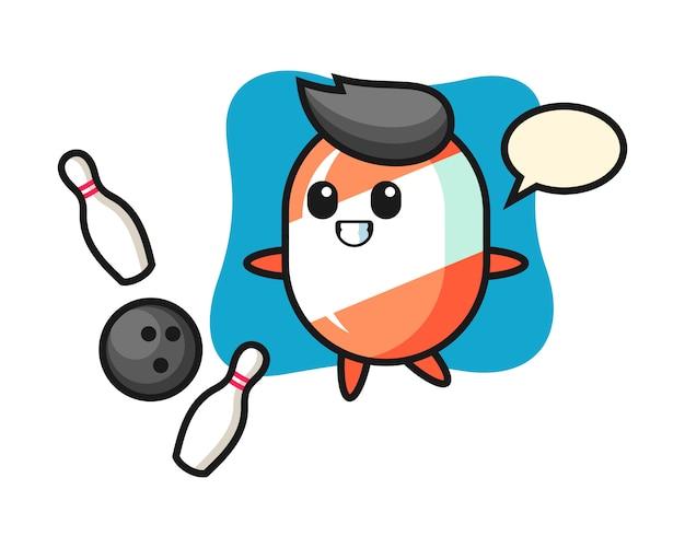 Персонаж мультфильма из конфет играет в боулинг