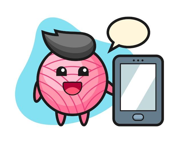 スマートフォンを持っている糸玉漫画