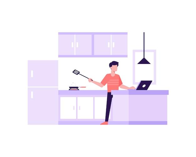 男は仕事をしながらラップトップの図の概念を入力しながらキッチンで料理をします