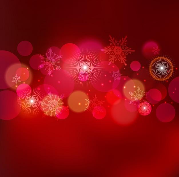 ボケ味を持つ抽象的なクリスマス明るい背景