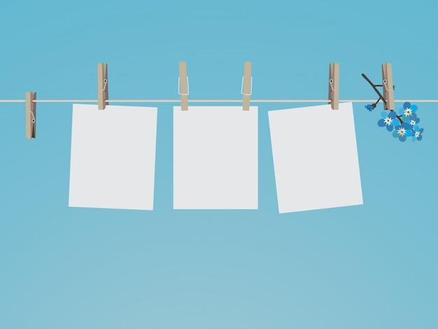洗濯はさみに掛かっている空白のフォトフレームセット