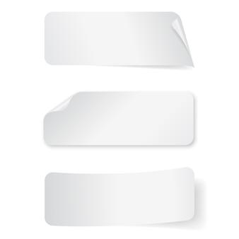 白い背景の空の紙長方形ステッカーのセット。