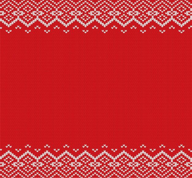 ニットクリスマスの背景。赤と白の幾何学的な飾り。クリスマスニット冬セーターテクスチャデザイン。