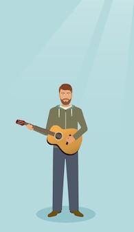 一人で立っている楽器のギタリスト。ギターを持つミュージシャン男。