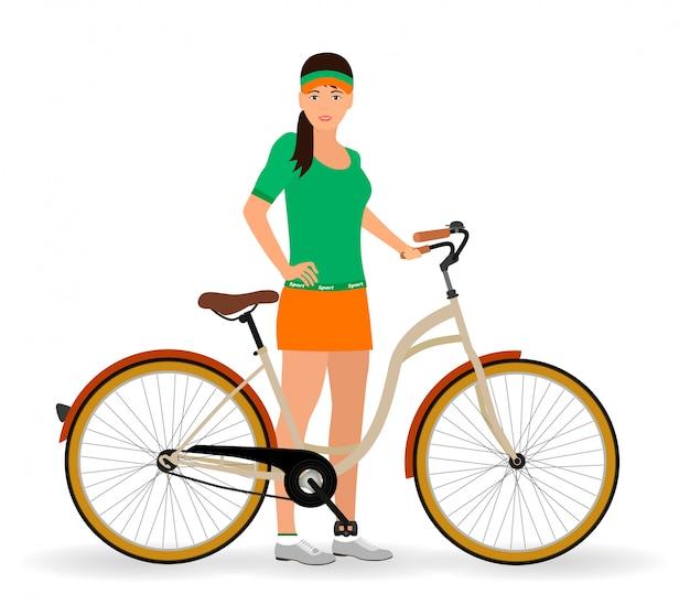 Спортсменка стоит с велосипедом. здоровые люди.