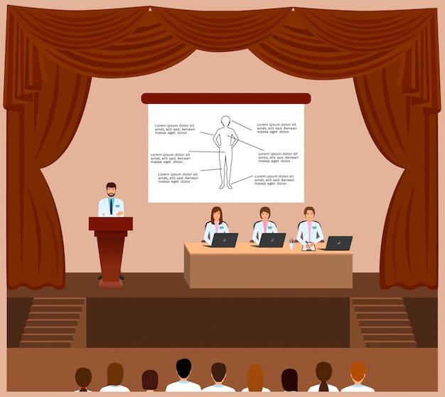 アセンブリホール内部での医療会議セッション。表彰台の後ろのスポークスマンと彼を聞いている医師。
