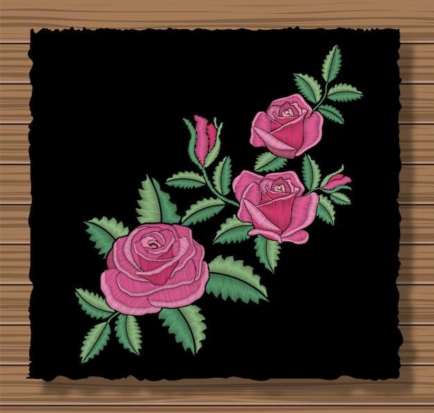ステッチ花と小枝と花のステッチ飾り。暗いフラップ布に刺繍のバラと葉