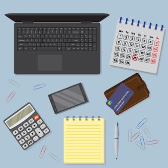 ラップトップ、デジタルデバイス、金融およびビジネスオブジェクトを含むオフィスデスク背景のビュー。