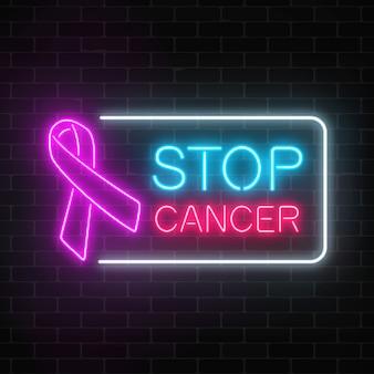 Знак неоновой остановки рака светящийся на фоне темного кирпича стены. розовая лента как месяц осведомленности рака.