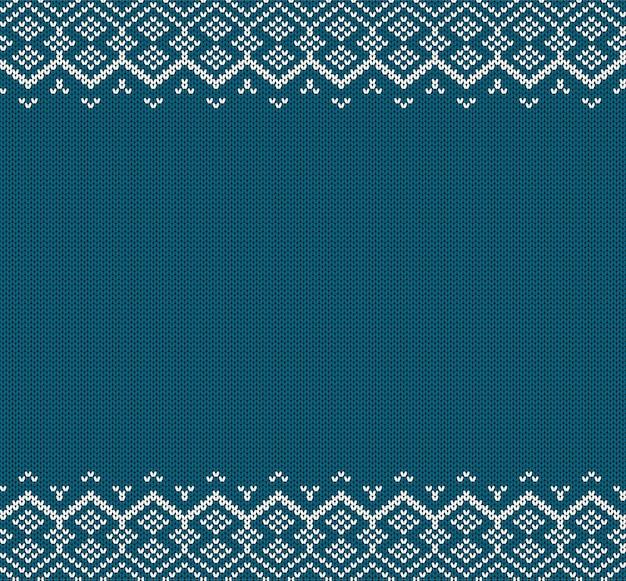 ニットの休日の幾何学的な飾りニットの青い色のセーターのテクスチャ。