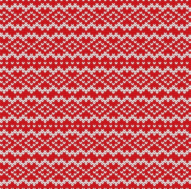 ニットセーターの幾何学的な装飾デザイン。シームレスパターン。