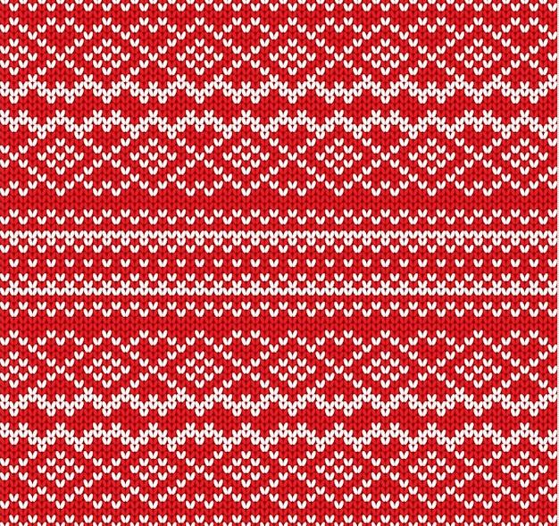 幾何学的な飾りのシームレスなパターンを編む。手作りのニットウェアのデザイン。ニット冬の赤い色のセーターのテクスチャ。