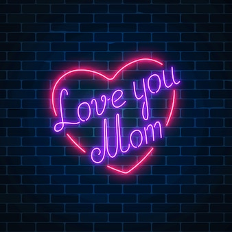 暗いレンガの壁の背景に幸せな母の日ネオン輝くお祝いサイン。ハートの形でお母さんを愛してください。