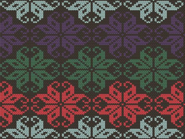 ニットの幾何学的な飾りのテクスチャ。ニットのシームレスパターン。さまざまな色の冬のセーター。