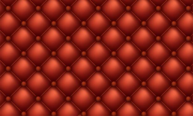 装飾的な室内装飾品のキルトの背景。赤い光沢のある革の質感のソファの背景。