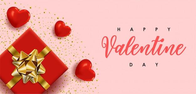 Счастливого дня святого валентина. романтический дизайн с красными сердечками и красной подарочной коробкой