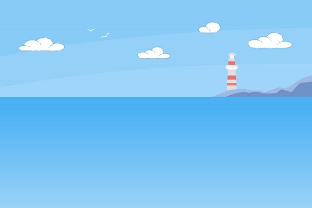 Башня маяка стоит на скалистом берегу моря