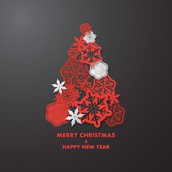 赤と白の雪のクリスマスツリー