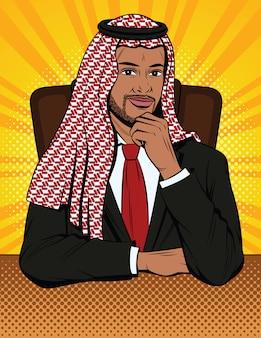 イスラム教徒のビジネスマンは彼のオフィスで考えています