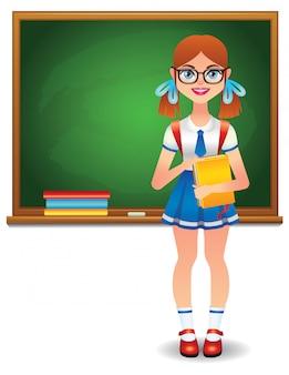 本と緑の教育委員会の前に立っている陽気な女の子