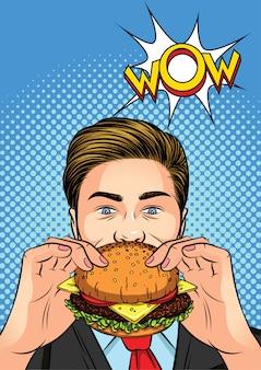 ポップアートスタイルの色ベクトルイラスト。ハンバーガーを食べている男。手にチーズバーガーを持つ男。