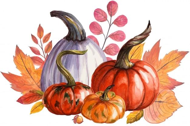 Красивая композиция с тыквами и осенними листьями.