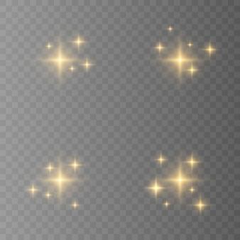 黄色、金、オレンジ色の輝きのシンボル。オリジナルの星の輝きアイコンのセット。明るい花火、装飾のきらめき、光沢のあるフラッシュ。